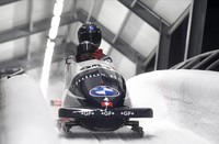 Michael Vogt and Sandro Michel of Switzerland finish their second run of the two man Bobsled World Cup race in Sigulda, Latvia, on Nov. 22, 2020. (AP Photo/Roman Koksarov)