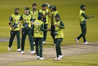 In this Tuesday Sept. 1, 2020 file photo, Pakistan players celebrate their win in the third Twenty20 cricket match against England at Old Trafford in Manchester, U.K. (AP Photo/Jon Super, Pool)