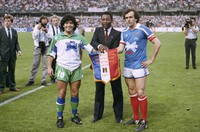 In this May 23, 1998 file photo, soccer stars Argentina's Diego Maradona, left, Pele of Brazil, center, and France's Michel Platini pose shaking hands during Platini's jubilee at Nancy stadium, eastern France. (AP Photo/Lionel Cironneau)
