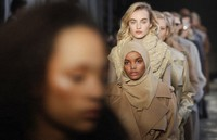 In this Feb. 23, 2017 file photo, Somali-American model Halima Aden wears a creation that's part of the Max Mara women's Fall-Winter 2017-18 collection, which was presented in Milan, Italy. (AP Photo/Luca Bruno)