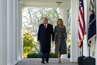 President Donald Trump and first lady Melania Trump walk out of the Oval Office and towards the Rose Garden of the White House, on Nov. 24, 2020, in Washington, to pardon Corn, the national Thanksgiving turkey. (AP Photo/Susan Walsh)