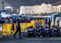 Migrants stand at the Arguineguin port on Gran Canaria island, Spain, after being rescued in the Atlantic Ocean by emergency workers on Oct. 19, 2020. (AP Photo/Javier Bauluz)