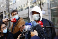 A music producer identified only by his first name, Michel, answers to media before going to the Inspectorate General of the National Police, known by its French acronym IGPN, in Paris, on Nov. 26, 2020. (AP Photo/Thibault Camus)