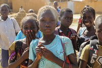 Balkissa Barro, 10, center, walks to school with friends in the Burkina Faso village of Dori on Oct. 20, 2020. (AP Photo/Sam Mednick)