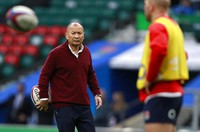 England coach Eddie Jones watches his players warm-up before the Autumn Nations Cup rugby union international match between England and Ireland at Twickenham stadium in London, on Nov. 21, 2020. (AP Photo/Ian Walton)