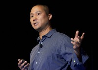 In this Sept. 30, 2013, file photo, Tony Hsieh speaks during a Grand Rapids Economic Club luncheon in Grand Rapids, Mich. Hsieh, retired CEO of Las Vegas-based online shoe retailer Zappos.com, has died.  (Cory Morse/The Grand Rapids Press via AP)