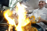 In this Jan. 7, 2009 file photo, Executive Chef Tory McPhail cooks Lemon and Garlic Crusted Wild Shrimp at Commander's Palace in the Garden District of New Orleans. (AP Photo/Alex Brandon)