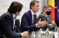 Belgium's Prime Minister Alexander De Croo, center, speaks during a news conference following a government meeting on the coronavirus, COVID-19, in Brussels, on Nov. 27, 2020. (AP Photo/Olivier Matthys)