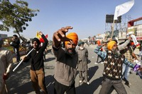 Protesting farmers shout slogans and face security officers at the border between Delhi and Haryana state, on Nov. 27, 2020. (AP Photo/Manish Swarup)