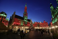 In this Nov. 24, 2020 file photo, people walk in the historic Grand Place during the official lighting of the Christmas tree in Brussels.  (AP Photo/Olivier Matthys)