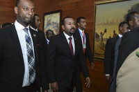 In this Feb. 9, 2020, file photo, Ethiopia's Prime Minister Abiy Ahmed, center, arrives for the opening session of the 33rd African Union (AU) Summit at the AU headquarters in Addis Ababa, Ethiopia. (AP Photo)