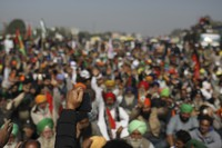 Protesting farmers shout slogans while blocking a major highway, refusing to move ahead unless they're allowed to proceed to their place of choice to protest, at the Delhi-Haryana state border, India, Saturday, Nov. 28, 2020. (AP Photo/Altaf Qadri)