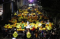 Protesters carry inflatable yellow ducks, which have become good-humored symbols of resistance during anti-government rallies, while marching towards the base of the 11th Infantry Regiment,a palace security unit under direct command of the Thai king, on Nov. 29, 2020 in Bangkok, Thailand. (AP Photo/Sakchai Lalit)