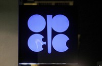 In this Dec. 19, 2019 file photo, the advertising label of the Organization of the Petroleum Exporting Countries, OPEC, shines at their headquarters in Vienna, Austria. (AP Photo/Ronald Zak)
