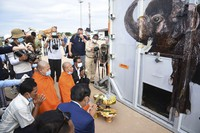 The container holding Kaavan the elephant is blessed by monks during its arrival from Pakistan at the Siem Reap International Airport, Cambodia, on Nov. 30, 2020. (Pool Photo via AP)