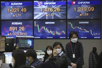 Currency traders work at the foreign exchange dealing room of the KEB Hana Bank headquarters in Seoul, South Korea, on Dec. 1, 2020. (AP Photo/Ahn Young-joon)