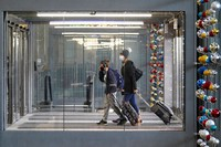In this Nov. 29, 2020 file photo, travelers walk through Terminal 3 at O'Hare International Airport in Chicago. (AP Photo/Nam Y. Huh)