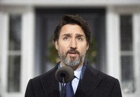 Canadian Prime Minister Justin Trudeau speaks at a bi-weekly news conference outside Rideau cottage on the COVID-19 pandemic in Ottawa, Ontario, on Nov. 27, 2020. (Adrian Wyld/The Canadian Press via AP)