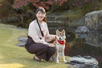 Princess Aiko poses with her dog at Akasaka Estate in Tokyo on Nov. 22, 2020. (Photo courtesy of the Imperial Household Agency/Kyodo)
