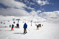 In this Feb. 22, 2019 file photo, people ride ski lifts as other skiers slide down the hill on a sunny day at the Faraya-Mzaar ski resort, in Faraya, northeast of Beirut, Lebanon. (AP Photo/Bilal Hussein)