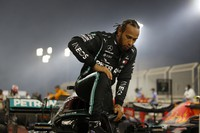Mercedes driver Lewis Hamilton of Britain exits his car after winning the Formula One race in Bahrain International Circuit in Sakhir, Bahrain, on Nov. 29, 2020. (Hamad Mohammed, Pool via AP)