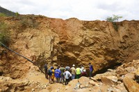 Government officials are seen at the sight of an abandoned mine where artisanal miners are trapped underground in Bindura about 70 kilometres northeast of the capital Harare, on Dec, 1, 2020. (AP Photo/Tsvangirayi Mukwazhi)