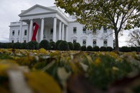 A ribbon hangs on the White House for World AIDS Day 2020, on Dec. 1, 2020, in Washington. (AP Photo/Evan Vucci)