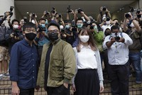 Hong Kong activists, from left, Joshua Wong, Ivan Lam and Agnes Chow arrive at a court in Hong Kong, on Nov. 23, 2020. (AP Photo/Vincent Yu)