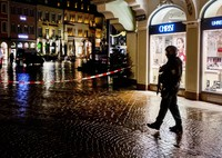Police officers guard the scene of an incident in Trier, Germany, on Dec. 1, 2020. (AP Photo/Michael Probst)