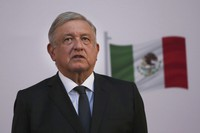 Mexican President Andres Manuel Lopez Obrador stands during the commemoration of his second anniversary in office, at the National Palace in Mexico City, on Dec. 1, 2020. (AP Photo / Marco Ugarte)