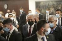 Israeli Prime Minister Benjamin Netanyahu, center, leaves the Israeli Knesset (Parliament) after a vote on the dissolution of the Knesset, in Jerusalem, on Dec. 2 2020. (Alex Kolomoisky/Pool via AP)