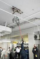 The monkey is seen eluding nets while bounding about in an underground car park in the Fukuoka Municipal Government office, in Chuo Ward, Fukuoka, on Dec. 3, 2020. (Mainichi/Osamu Sukagawa)