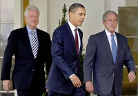 In this Jan. 16, 2010 file photo, then U.S. President Barack Obama, center, walks out of the Oval Office of the White House with former Presidents Bill Clinton, left, and George W. Bush, right, to deliver remarks in the Rose Garden at the White House in Washington. (AP Photo/Pablo Martinez Monsivais)