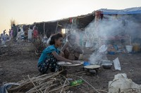 Tigray refugees who fled the conflict in the Ethiopia's Tigray cook breakfast at Hamdeyat Transition Center near the Sudan-Ethiopia border in eastern Sudan, on Dec. 3, 2020. (AP Photo/Nariman El-Mofty)