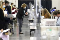Recount observers watch ballots during a Milwaukee hand recount of Presidential votes at the Wisconsin Center, on Nov. 20, 2020, in Milwaukee, Wis. (AP Photo/Nam Y. Huh)