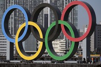 The Olympic symbol is reinstalled after it was taken down for maintenance ahead of the postponed Tokyo 2020 Olympics in the Odaiba area on Dec. 1, 2020, in Tokyo. (AP Photo/Eugene Hoshiko)
