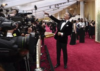 Tom Hanks arrives at the Oscars in Los Angeles on Feb. 9, 2020. (Photo by Jordan Strauss/Invision/AP)