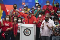 Venezuela's President Nicolas Maduro speaks to supporters during a closing campaign rally for the upcoming National Assembly elections in Caracas, Venezuela, on Dec. 3, 2020. (AP Photo/Ariana Cubillos)