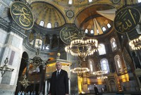 Turkey's President Recep Tayyip Erdogan poses for photos after Friday prayers inside Hagia Sophia Mosque, in Istanbul, on Dec. 4, 2020. (Turkish Presidency via AP, Pool)