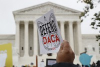 In this Nov. 12, 2019 file photo, people rally outside the Supreme Court as oral arguments are heard in the case of U.S. President Trump's decision to end the Obama-era, Deferred Action for Childhood Arrivals program (DACA), at the Supreme Court in Washington. (AP Photo/Jacquelyn Martin)