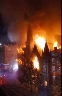 Firefighters work to extinguish a fire that erupted from a building next to Middle Collegiate Church on Saturday, Dec. 5, 2020 in New York. (Duke Todd via AP)