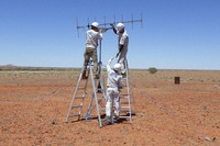 In this photo provided by JAXA, its crew members set up antenna in the preparation for the operation for the capsule collection in Woomera, South Australia in November, 2020. (JAXA via AP)