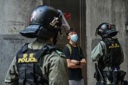 香港では6月に国家安全維持法が施行され、デモ参加者への監視も強まった Bloomberg