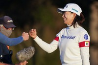 Hinako Shibuno, of Japan, fist bumbs fellow players after her round of golf during the third round of the U.S. Women's Open golf tournament, Saturday, Dec. 12, 2020, in Houston. (AP Photo/Eric Gay)