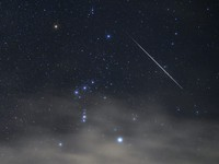 A shooting star, part of the annual Geminid Meteor Shower, streaks across the night sky near the constellation Orion, in this photo taken in the village of Yamanakako, Yamanashi Prefecture, early on Dec. 14, 2020. (Mainichi/Koichiro Tezuka)