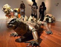Teppei, the aquatic iguana, artist Natsumi Tomita's first sculpture she made from scrap, is seen in front of other works by the sculptor at her exhibition at the Yamazaki Mazak Museum of Art in Nagoya on Nov. 13, 2020. (Mainichi/Yasuo Yamada)
