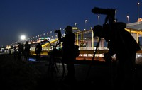 Astronomy fans are seen trying to capture images of Jupiter and Saturn close together, in Tokyo's Katsushika Ward on the evening of Dec. 17, 2020. (Mainichi/Natsuki Nishi)s