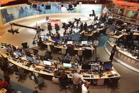 In this June 8, 2017 file photo, Al-Jazeera staff work at a TV station in Doha, Qatar. (AP Photo/Malak Harb)