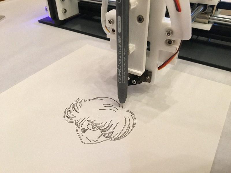 AIのデータをもとに、ロボットアームで描かれた「ぱいどん」=東京都文京区で2020年2月、高橋祐貴撮影