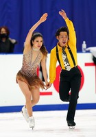 Ice dancer Kana Muramoto, left, is seen practicing with partner Daisuke Takahashi at an official practice session for the national championships at the Big Hat arena in Nagano, central Japan, on Dec. 24, 2020. (Pool photo)